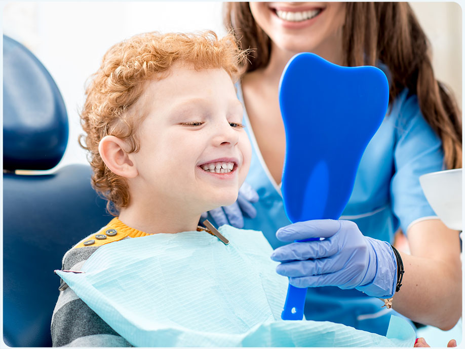 Boy with dentist at Radiant Dental Centre